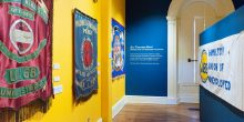 Installation photo of All Together Now, featuring labour banners from WAHC's permanent collection.